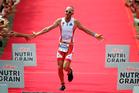 Bevan Docherty of New Zealand celebrates winning the New Zealand Ironman. Photo / Getty Images.