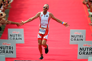 Bevan Docherty of New Zealand celebrates winning the New Zealand Ironman. Photo / Getty Images.