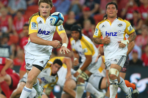 Beauden Barrett of the Hurricanes passes during the round three Super Rugby match between the Reds and the Hurricanes. Photo / Getty Images.