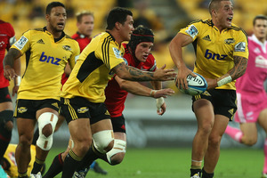 TJ Perenara of the Hurricanes looks to pass during the round four Super Rugby match between the Hurricanes and the Crusaders. Photo / Getty Images.