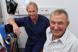 Ian Ingham (right) and urologist Peter Gilling.