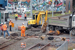 Work goes on at a Morningside level crossing after a near-fatal incident involving a woman in a wheelchair. Photo / Doug Sherring