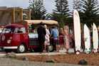 Adam Strange's coffin arrives at his funeral, held at Muriwai Surf Club, Muriwai Beach. Photo / Sarah Ivey