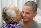 Gemma Singleton gets a hug from her grandmother, Elizabeth Singleton, after former Silver Fern Temepara George cut Gemma's long curly locks off at her school assembly yesterday. Photo / Greg Bowker
