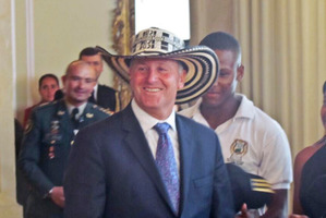 Prime Minister John Key accepted his fate and wore a sombrero vueltiao, given to him by a Colombian rugby representative. Photo / Supplied