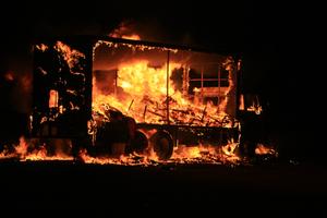 The truck ablaze on Papamoa Beach Road. Photo / Bay of Plenty Times