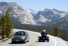Tourists drive along Highway 120, the Tioga Road, at Olmsted Point in Yosemite, California. Photo / AP