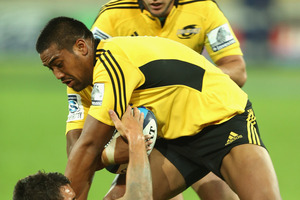 Julian Savea fends off Crusaders' five-eighths Daniel Carter last night. Photo / Getty Images