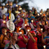 People held up candles and images of Venezuela's President Hugo Chavez during candlelight vigil to pray for his health before his passing. Photo / AP