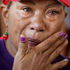 A supporter of Venezuela's President Hugo Chavez wipes away tears as she prays for the president. Photo / AP