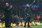 Manchester United's manager Sir Alex Ferguson, left, reacts as Real Madrid's coach Jose Mourinho from Portugal gestures from the touchline. Photo / AP