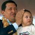Venezuela's President Hugo Chavez covers the ears of his grandson Manolito as they watch a display by Hindustan Aeronautics. Photo / AP