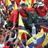Venezuela's President Hugo Chavez drives a truck as he waves to supporters during a rally commemorating the 151st anniversary of the Federal War in Caracas. Photo / AP