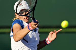Marina Erakovic returns a shot to Shahar Peer, of Israel, during their match at the BNP Paribas Open tennis tournament. Photo / AP