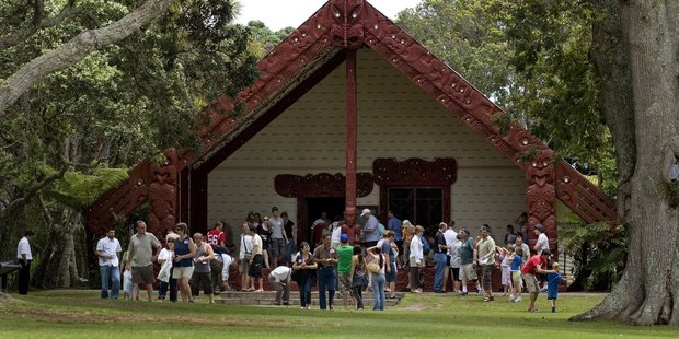 Tourists gather outside Te Whare Runanga at the Waitangi Treaty Grounds in the Bay of Islands. Photo / APN