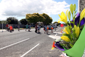 Children walk over the crossing after school which was the were a 12 year old boy on a bike was killed after being hit by a van in Guppy Road. Photo / HBT