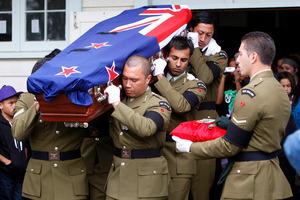 Comrades carry the coffin of Corporal Douglas Hughes at his funeral at Te Terai o Rahiri Marae at Pakotai in Northland last April. Photo / APN