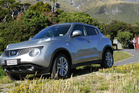 Nissan Juke beside Mt Egmont and Camphouse hut at North Egmont.