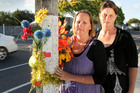 Sonia Ross and Hayley Berriman, aunties of a 12-year-old boy who was killed on Guppy Rd two years ago, are disappointed the roadside tributes are to be removed.  Photo / Warren Buckland