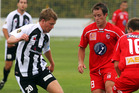  Hawke's Bay United #20 Conor Tinnion with ball as Waitakare United #8 Chad Coombes attacks the ball. Photo / Glenn Taylor