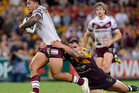 Jorge Taufua of the Sea Eagles is tackled by Corey Parker of the Broncos. Photo / Getty Images.