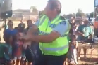 Constable Ross Humphrey shows off his dance moves at Pihanga Street Reserve. Photo / YouTube/Supplied