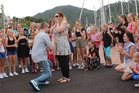 Andrew Bewley gets down on one knee to propose to partner Jenny Sanders at Whangarei Town Basin, surrounded by a dancing flash mob.  Photo / Supplied