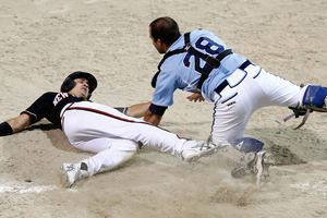 Tyson Byrne slides to base as Bruno Montroni of Argentina attempts the tag. Photo / Getty Images