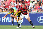 Mark Bridge of the Wanderers competes for the ball against Ben Sigmund of the Phoenix.  Photo / Getty Images