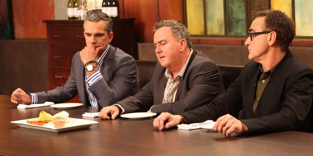Josh Emett, Simon Gault and Ray McVinnie ponder Vanessa's plate.
