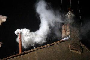 White smoke emerges from the chimney on the roof of the Sistine Chapel in St Peter's Square at the Vatican. Photo / AP