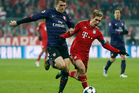Arsenal's Aaron Ramsey, left, and Bayern's Philipp Lahm challenge for the ball during the Champions League round of 16 second leg soccer match between FC Bayern Munich and FC Arsenal. Photo / AP