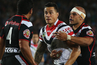 Sonny Bill Williams of the Roosters fights back with Konrad Hurrell of the Warriors. Photo / Getty Images.