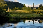 The ruins of the 6th-century monastic settlement of Glendalough, founded by St Kevin, rest in the Wicklow mountains. Photo / Supplied