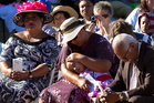Worshippers were joined by onlookers at the church service at Western Springs Reserve yesterday. Photo / Brett Phibbs
