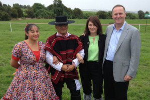 Prime Minister John Key and wife Bronagh pose with Chilean dancers at Fonterra's farm in Chile. Photo / Claire Trevett