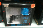 This loosely-themed <i>Dirty Harry</i> mug and gun Easter egg combo, spotted in The Warehouse, Whangaparaoa, was a bit alarming for one reader who wonders what a handgun has to do with Easter. Photo / Supplied