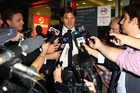 Cricketer Shane Watson fields a media scrum after he quit the Australian team in India when he was punished by his coach. Photo / Getty images