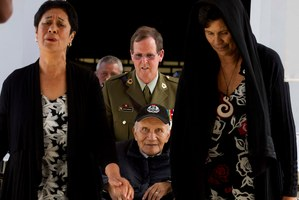 One of the Maori Battalion veterans is escorted into the army museum yesterday. Photo / Alan Gibson