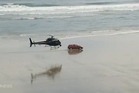 A helicopter covers all the angles of the race on Ninety Mile Beach. Photo / One News