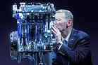 Ford GM Alan Mulally kisses a three-cylinder engine. Photo / Supplied