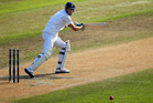 Steven Finn of England hits a four during day five of the First Test match between New Zealand and England at University Oval. Photo / Getty Images