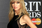 Taylor looked stunning in a black Elie Saab gown for the BRIT Awards. Photo / AP