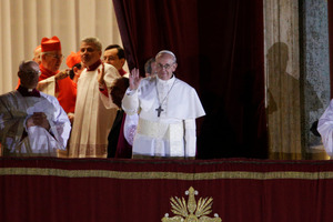 Pope Francis flanked by Monsignor Guido Marini, master of liturgical ceremonies, waves to the crowd. Photo / AP