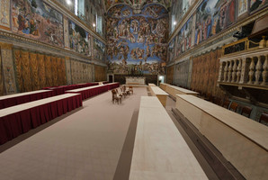 The Sistine Chapel where the cardinals will hold their conclave and (below) firefighters place the chimney that will signal a new pope has been elected. Photo / AP