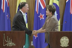 Prime Minister John Key shakes hands with Brazil's President Dilma Rousseff in Brasilia. Photo / AP