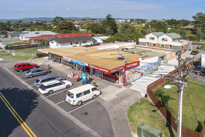 Four retail units, three flats and two modern townhouses are for sale at 93-95 Vodanovich Road, Te Atatu South. Photo / Supplied