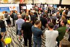 People queue up at one of the mining stalls during the Oz Jobs Expo. Photo / NZ Herald