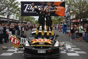 Highlands Motorsport Park owner Tony Quinn and Co Driver Naomi Tillett after their 2012 Targa NZ win. Photo / Groundsky Photography