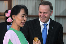 Prime Minister John Key and Aung San Suu Kyi. Photo / Alan Gibson